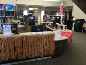 Reference desk decorated for the Winter Beach Party