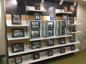 Shelving display of photography by Robin Cumberland