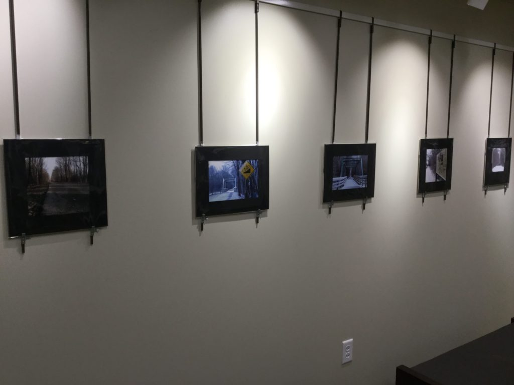 Wall display of photography by Robin Cumberland