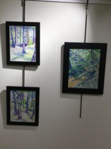 Trio of blue forest scenes