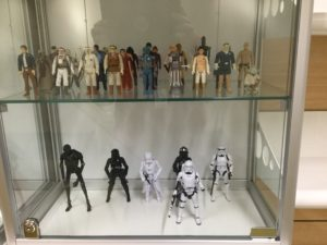 Star Wars action figures in a locked case