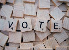 "Scrabble tiles spelling ""vote"""